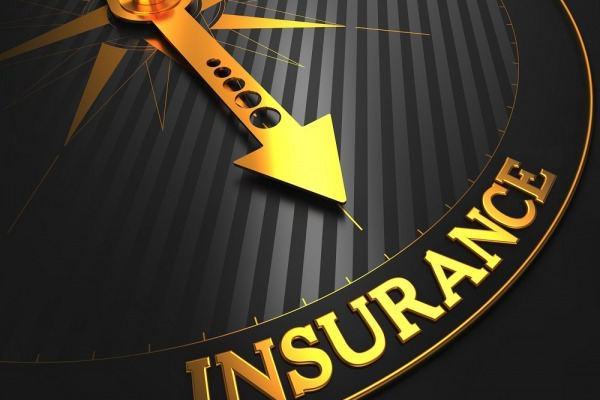 """Insurance - Business Background. Golden Compass Needle on a Black Field Pointing to the """"Insurance"""" Word."""